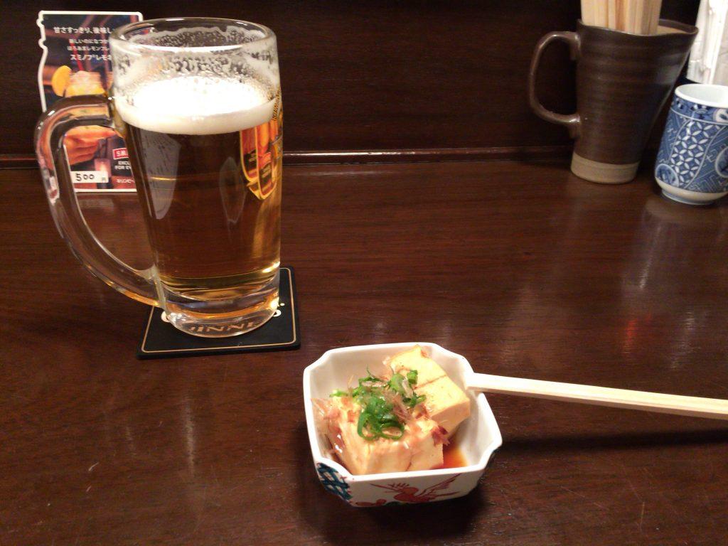 生ビールとお通しの豆腐