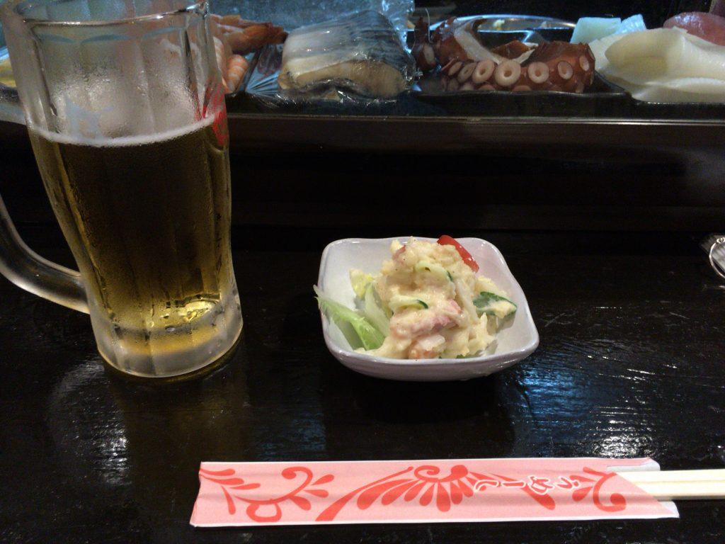 オリオン生ビールとお通しのポテトサラダ